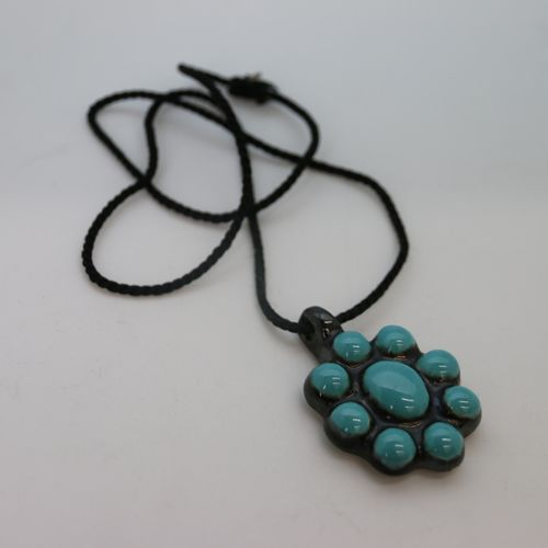 BAUCHET XXth century  Poly lobed medallion in turquoise and black enamelled eart…