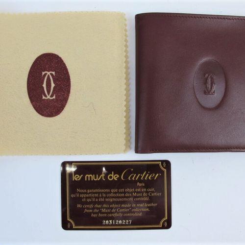 CARTIER Must de Cartier  Wallet in burgundy calf leather, embossed double C mono…