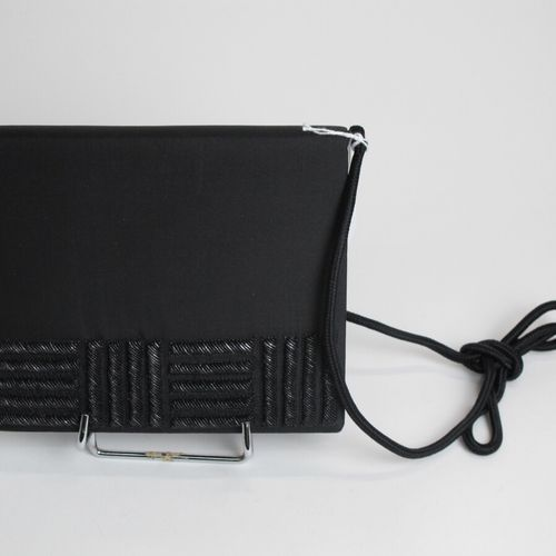 ADITY  Evening clutch bag in black silk and embroidered with silver threads. Ins…