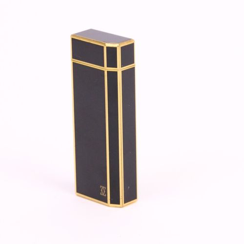 CARTIER  Gas lighter in gold plated and black lacquer. Signed and dated.  Number…
