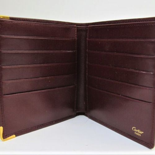 CARTIER Must de Cartier  Wallet in burgundy calf leather, embossed double C mono…