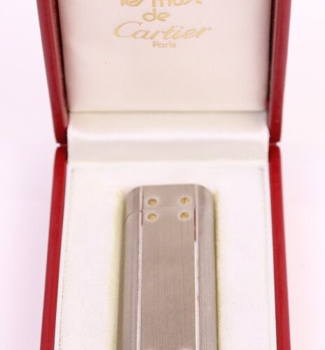 CARTIER  Gas lighter in brushed silver metal and twelve screws in gold metal. Si…