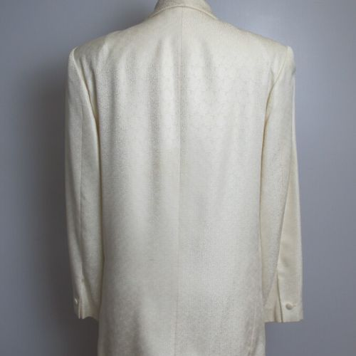 PIERRE CARDIN  Tuxedo jacket in beige brocaded silk with botheh decoration, clos…