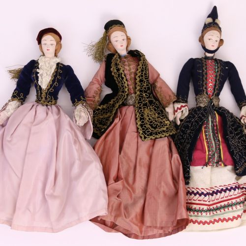 Set of three rag dolls in traditional silk, cotton and velvet embroidered costum…