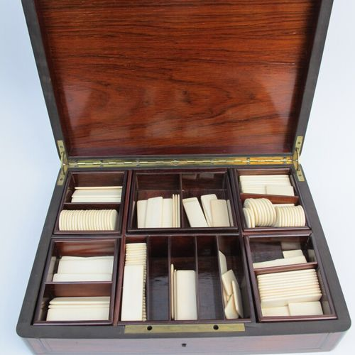 Rosewood game box inlaid with brass filet and a blackened wood, mother of pearl …