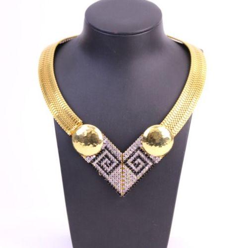 L.DEMARIA  Collier en métal doré centré d'un motif triangulaire articulé orné de…