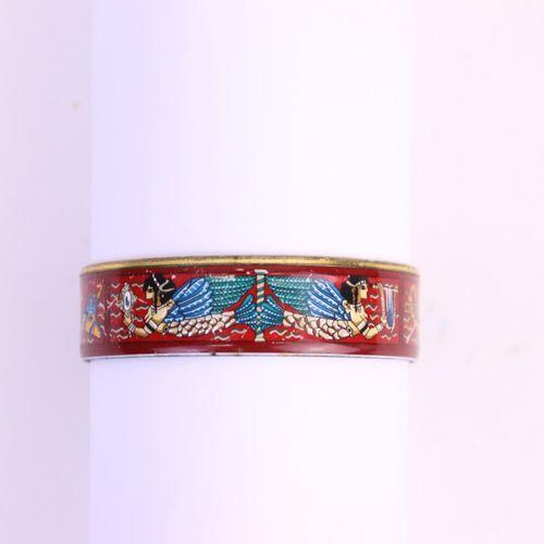 HERMES Paris made in Austria  Bracelet jonc en métal doré et émaillé polychrome …