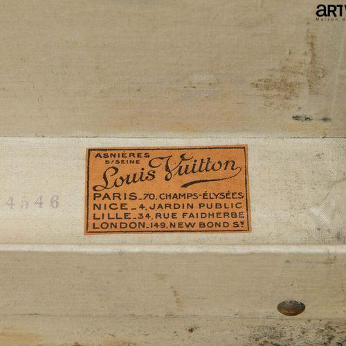 LOUIS VUITTON  Valise en toile enduite noir  Intérieur en coton avec ses sangles…