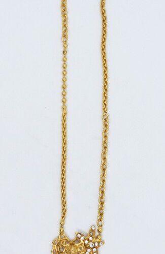 Christian LACROIX  Collier composé de cinq variétés de chaînes en métal doré, ce…