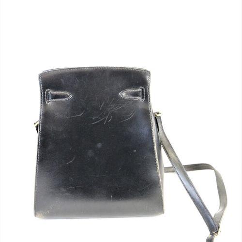 HERMES PARIS  Sac 'Kelly sport' en veau box noir, doublure intérieure en agneau …