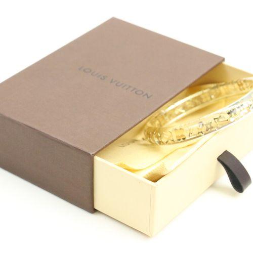 LOUIS VUITTON  Bracelet jonc en plexiglass et composite translucide, orné d'incl…