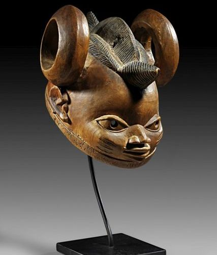 AFRIKA UND OZEANIEN Helmet mask gelede of light coloured wood with elaborate cre…