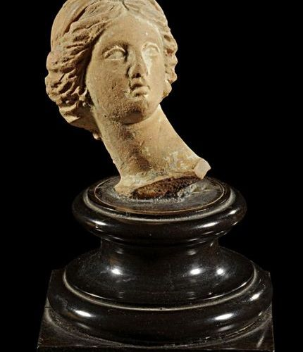 LOT Hellenistic terracotta head of a girl. Charming style. Hellenistic period, 3…