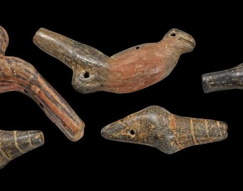 LOT Collection of six clay whistles in the shapes of birds and seashells. All in…