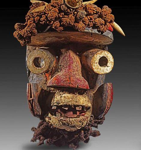 LOT We, Ivory Coast bush spirit mask with tubular eyes, open mouth showing the i…