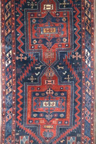 Large handmade woollen Kazak rug decorated with two red and blue geometric medal…