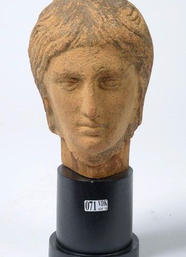 """Votive head representing a young woman with long hair"" in terracotta. Etruscan …"