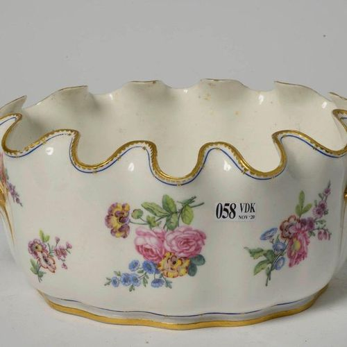 Oval poly lobed cooler in polychrome Sèvres porcelain with floral decoration. Ma…