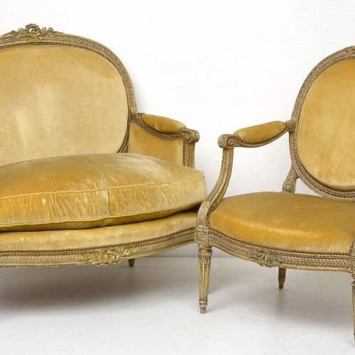 A Louis XVI armchair and marquise in carved wood and gold patina with a medallio…