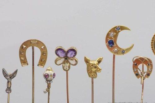 12 jewels: Eleven 18 karat yellow gold tie pins set with enamel, diamonds, sapph…