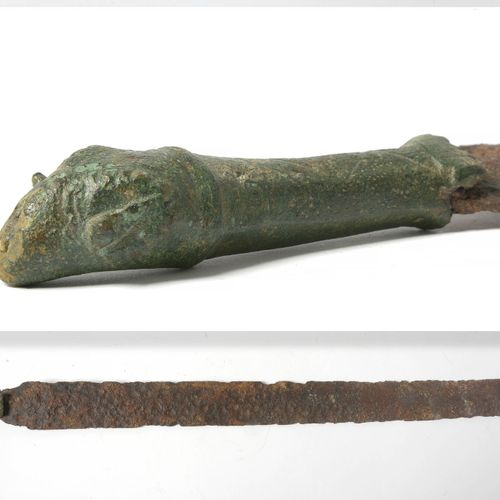 """Short iron sword with a bronze handle whose pommel represents a stylized """"Ram's …"""