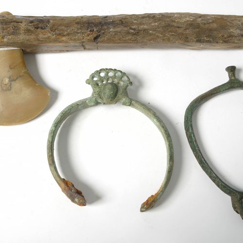 Set of three including: a Roman bronze stirrup. Period: end of the 5th century. …
