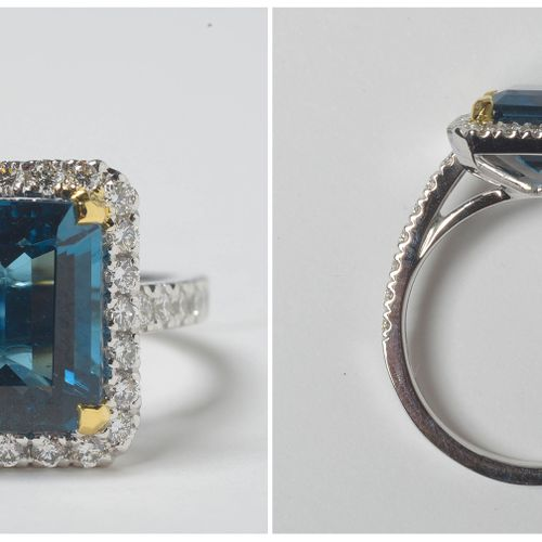 "18K白金戒指,镶嵌4.57克拉的伦敦蓝祖母绿切割黄宝石和明亮型切割钻石,总重+/ 0.64克拉(颜色:D E;净度:VVS VS)。附上2021年的 ""安特卫…"