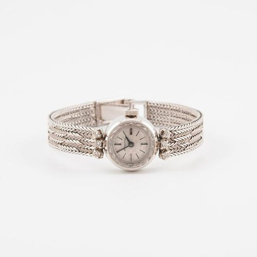 ZENITH  Montre bracelet de dame en or gris (750)  Boîtier rond, attaches serties…