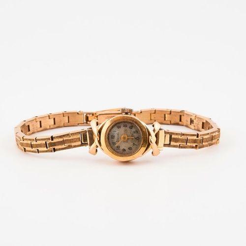 Montre bracelet de dame.  Boîtier rond en or jaune (750), attaches en noeud.  Ca…