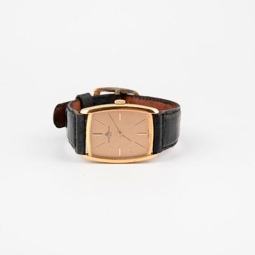 BAUME & MERCIER  Montre bracelet de d'homme.  Boîtier tonneau en or jaune (750).…