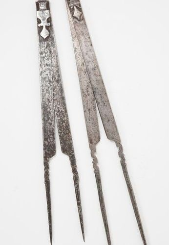 Two carpenter's compasses made of beaten and cut iron.  Shafts decorated with st…