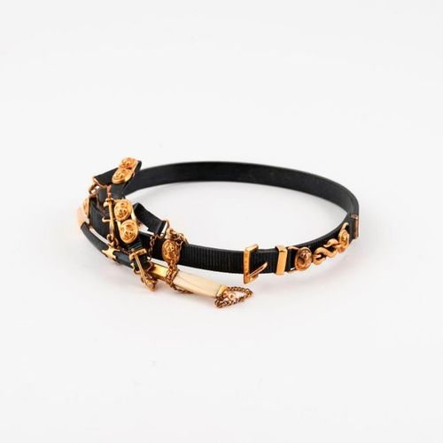 Black steel bracelet grooved in the shape of a miniature belt with gold metal bu…