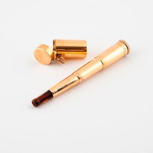 Cigarette smoker in yellow gold (750) retractable with its small yellow gold (75…