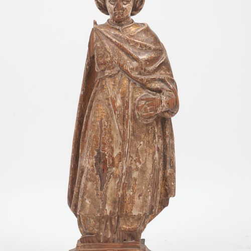 Début du XVIIIème siècle. Statuette of Saint (?) in carved wood.  Traces of poly…