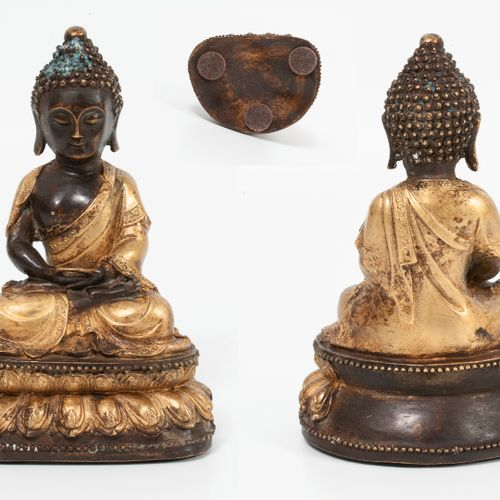TIBET, XIXème siècle. Bronze Amitabha Buddha statue with a double golden and bro…