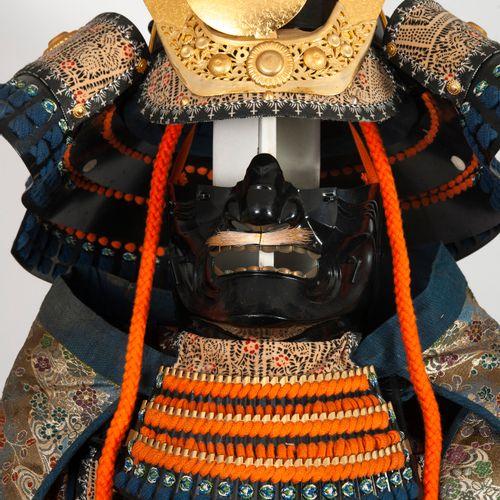 JAPON, XXème siècle Decorative samurai armor made of blackened metal, fabric and…