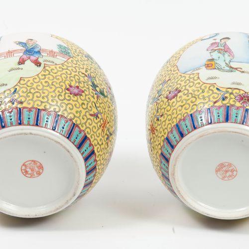 CHINE, XXème siècle Two polychrome enamelled porcelain ginger pots decorated wit…