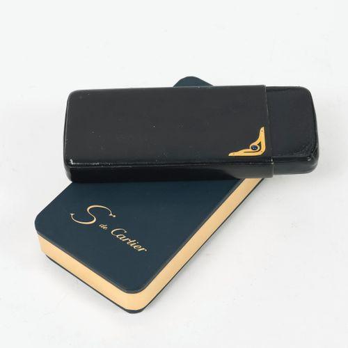 S de CARTIER, Paris Black leather case with gilded metal clasp, openwork, decora…