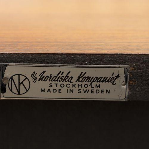 Erik HERLOW (1913 1991) Enfilade.  En métal et bois exotique.  Ouvrant par cinq …