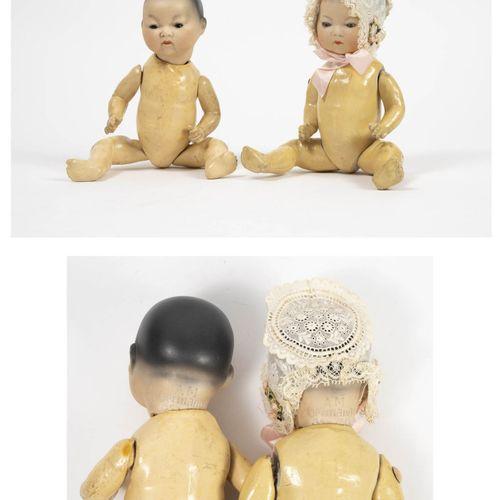 ARMAND MARSEILLE Deux poupons jumeaux asiatiques.  Têtes pleines en porcelaine a…