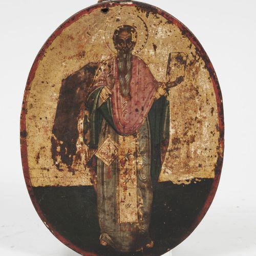 Saint homme tenant la Bible.  Icône orthodoxe ovale de foyer.  Tempera sur fond …