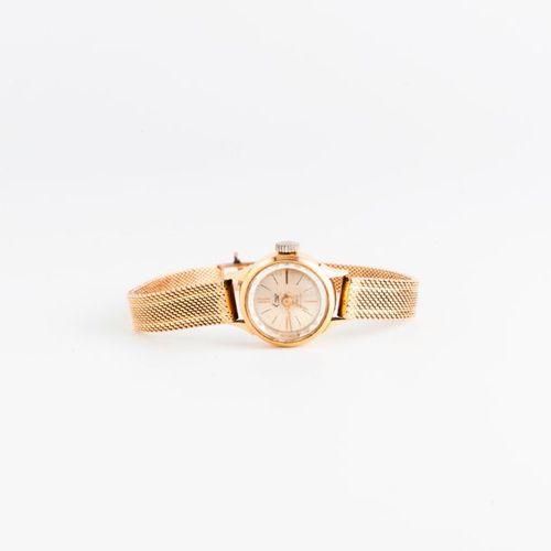 EMO  Montre bracelet de dame en or jaune (750).  Boîtier circulaire.  Cadran à f…