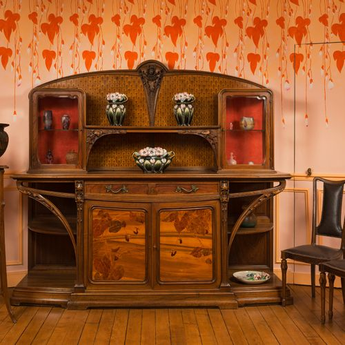 """MAJORELLE Louis (1859 1926) """"Chicorée"""" dining room in moulded and carved walnut …"""