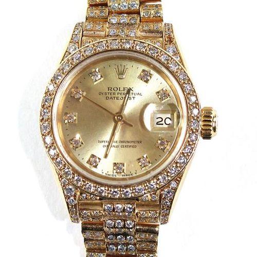 Rolex Damenarmbanduhr 配有Oyster Perpetual Datejust表带。约1989年。18K黄金表壳,镶有钻石的表圈。参考691…