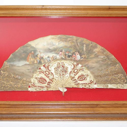Fächer 19.Jh. 附有华托的画作。扇子可能是用骨头做的,涂抹和锯开。叶子上画着瓦托之后的风俗画《El Embarque Para Citerea》。在…