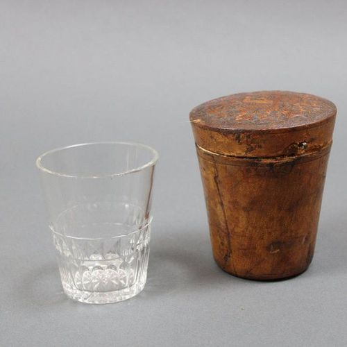 Cut crystal goblet glass and its leather travel case. 19th century. H. 11 cm. Sm…