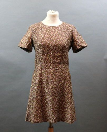 CACHAREL, circa 1970  Brown cotton dress with flowers, buttoning in the back, T.…