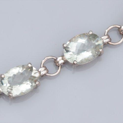 Bracelet en argent 925, serti de prasiolites ovales, fermoir aimanté. 23.6 g. L:…