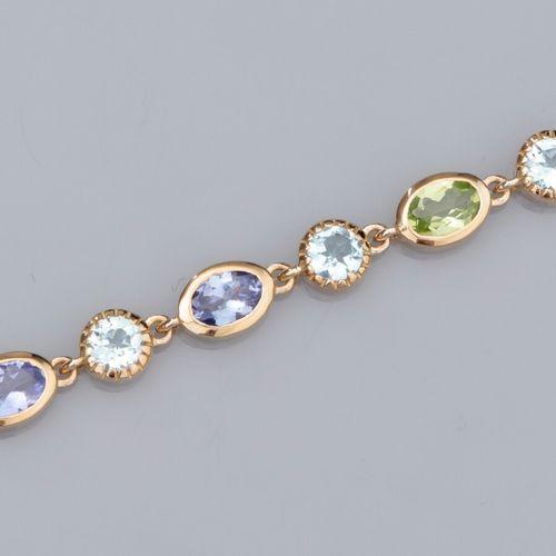 Bracelet en vermeil 925, serti de tanzanites, de topazes bleues et de péridots (…