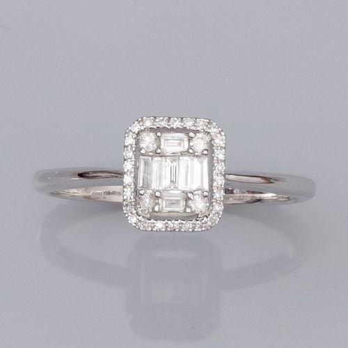 Bague en or gris 750°/°° (18K) , sertie de diamants baguettes et de diamants tai…